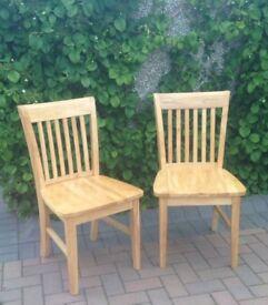 Set of 2 light oak dining chairs