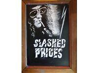 Slash-art work on black chalk board.