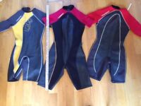 Three wetsuits for young to mid-teenagers