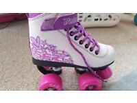 Girls rollerskates nearly new size 12J