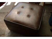 Large brown storage stool on castors
