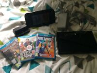 Nintendo Wii U console and 4 games
