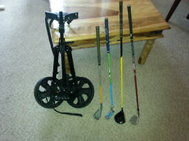 various junior golf clubs and trolley
