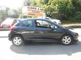 Peugeot 207 sport 3 door h/b 1.4cc in black comes with 12 MOT and service history drive very nice