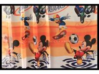 Brand new set of two Disney voile net curtains and matching placemat.