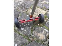Moss remover scarifier