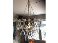 Unique Hanging Lampshade made up of wine glasses