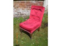 Low atrmless chair suitable for nursing.