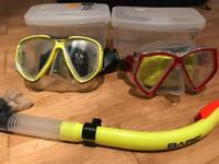 Selection of diving equipment - masks, snorkel, flippers, shoes, hand paddles