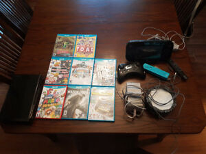 Wii U 10 games, pro controller and 2 wii remotes