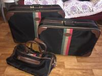2 suitcases and shoulder bag