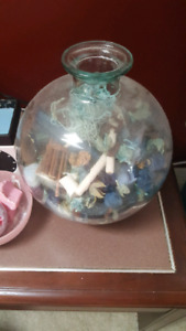 Glass ball vase filled with potpourri