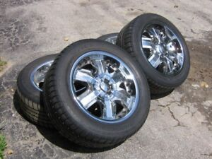 American Racing rims with tires.