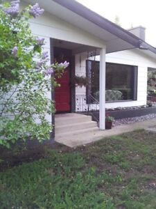 Beautiful, Private Acreage STEPS from Sherwood Park