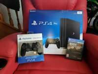 PlayStation 4 Pro + Spare Dual Shock 4 v2 + Game