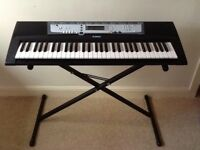 Electric Yamaha E213 keyboard with stand.