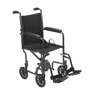 New in Box Transport wheelchair - light easy to fold
