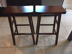 "Two 29 "" saddleback stools - brown wood - $130"