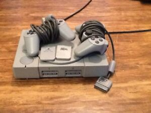 PS1, 2 controllers, 2 memory cards, 10 games