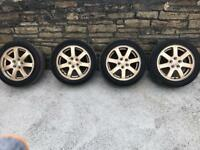 "15""Subaru alloys excellent condition plus tires"