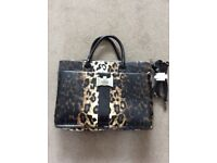 Hand Bag by LYDC, animal print, size width 39 cm , height 27 cm . Comes with shoulder strap, £5.00 .