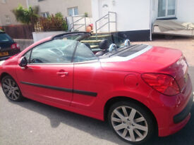 Beautiful Flamingo Red Peugeot 207 CC Convertible with very small Mileage