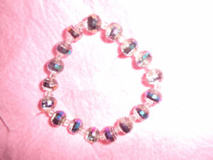 on colourful beaded stretch bracelet and one solid gold tone 2.0
