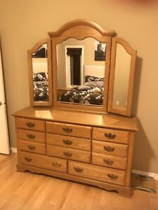 Solid oak dresser with curved, bevelled mirror w/two nightstands