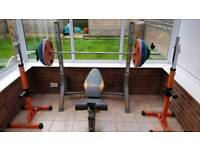 Olympic weight set with bench and squat stands