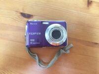 Purple Fujifilm FinePix AX550 16 megapixel camera with 5 x zoom and HD Movie