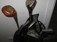 New golf bag with assortment of clubs.