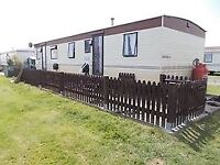 static caravan,mobile home, sited at hutleys st osyth,lovely site.for sale due to health.