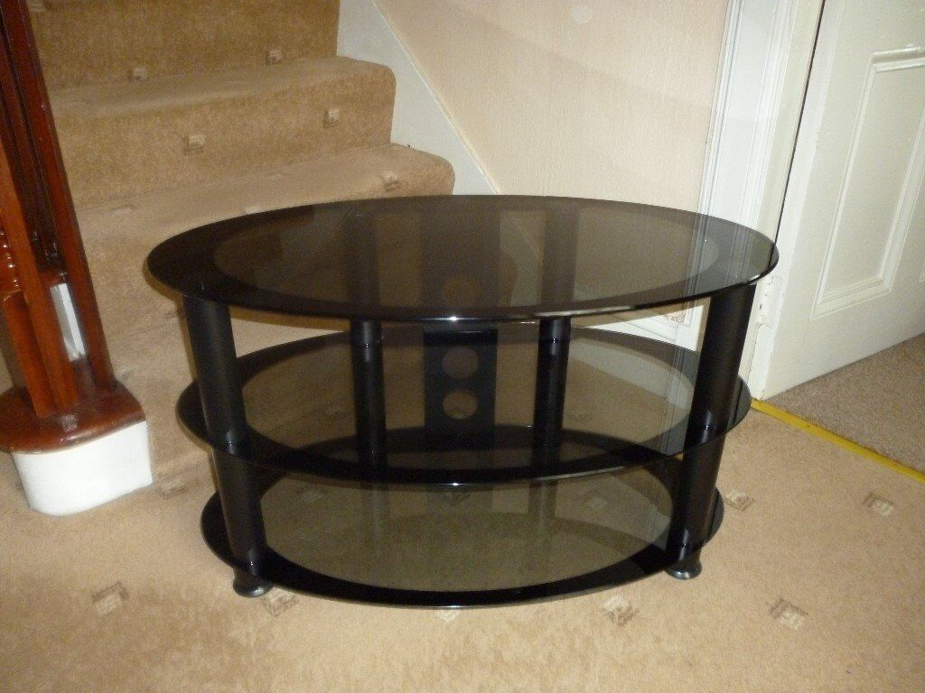 Oval smoked glass television stand