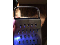 Metal cheese grater