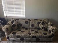 Sofa, flower print, with matching foot stool.