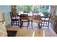 Ercol Colonial Dark Wood Dining Table and Six Chairs incl Two Carvers