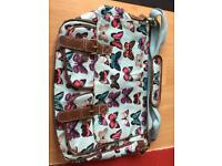 Blue butterfly strap bag