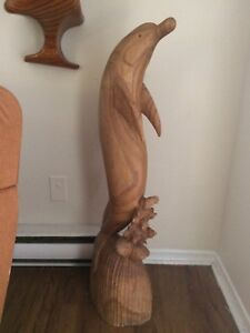 Well carved wooden dolphin