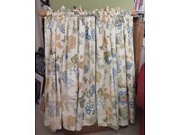Set of lined cotton curtains ready to hand on pole with all fixings