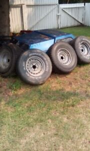 """2 BRAND NEW 31"""" M&S Tires on 15x8 5 bolt classic chevy wheels."""
