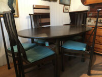 ERCOL Elm Dining table , which extends , with 6 chairs , all in excellent condition .