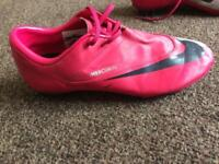 Girls Nike football boots and shin pads and gloves