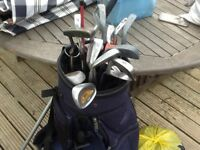 Light weight bag,trolley, assorted clubs and ball retriever