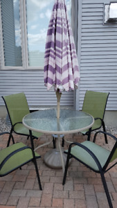 Outdoor table, umbrella and four chairs