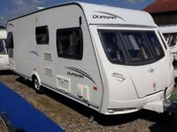 2010 Lunar Quasar 544 Fixed Bed End Washroom Caravan with Motor Mover