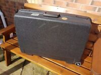 Delsey hard suitcase - large - with two wheels and pull handle