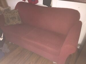 Free couch. Also mattress, box spring, frame and shelves