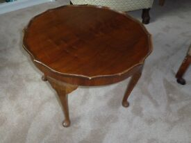 Walnut occasional table with pie crust border and cabriole legs