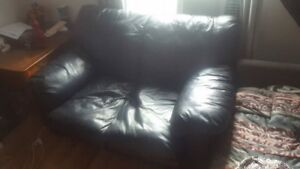 Brand new real leather love sofa.