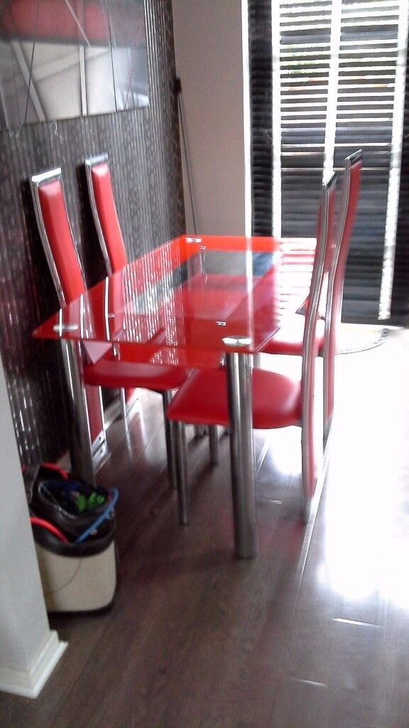 Red and chrome glass dining table and chairs for sale excellent condition 100 pounds